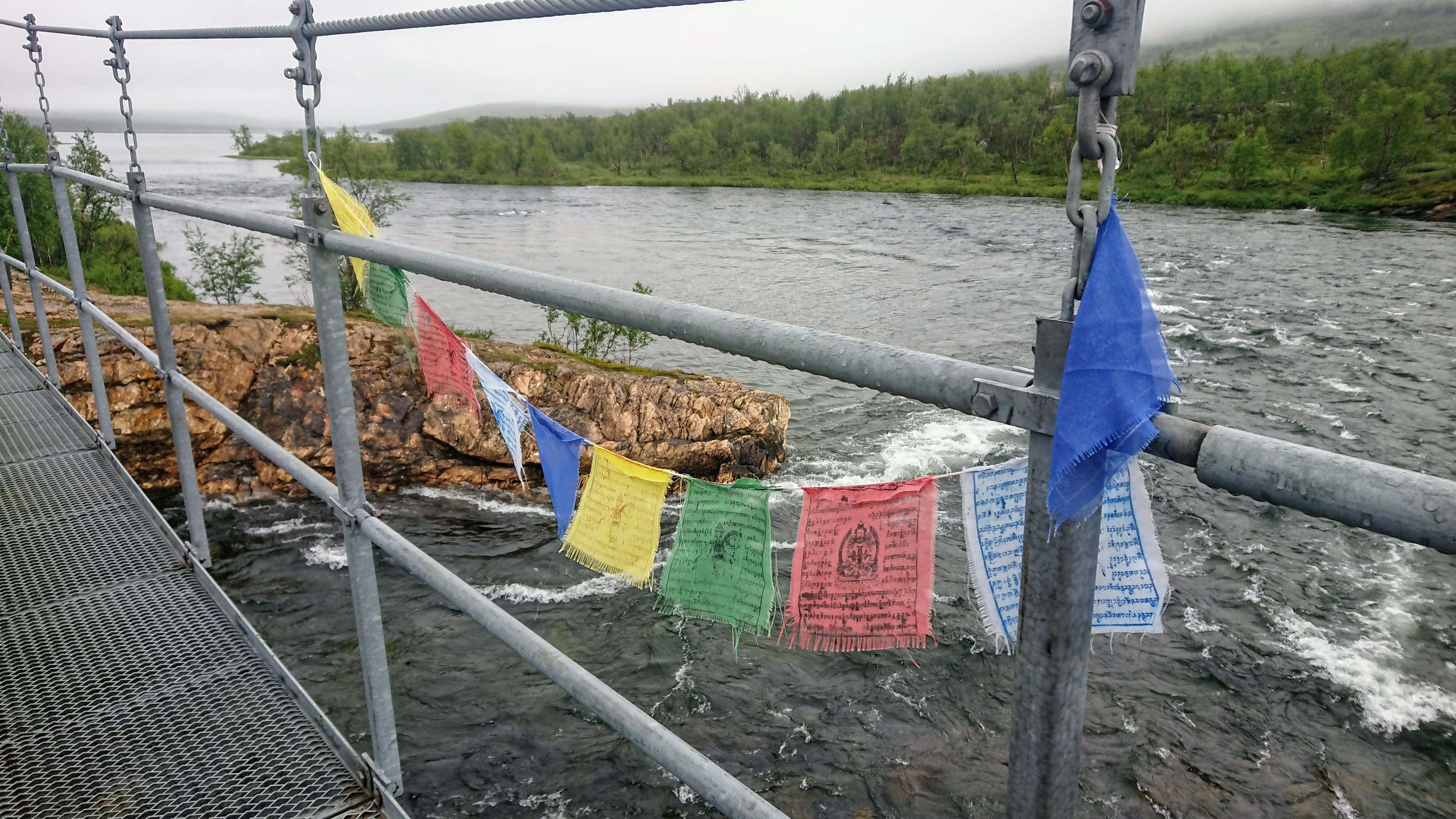Prayer flags on a bridge before Abiskojaure