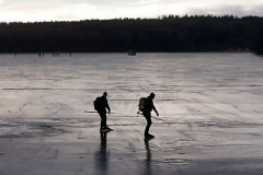 Skaters on the ice at lage Mälaren.