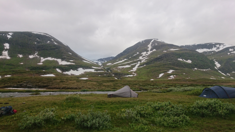Tent by a river on Kungsleden