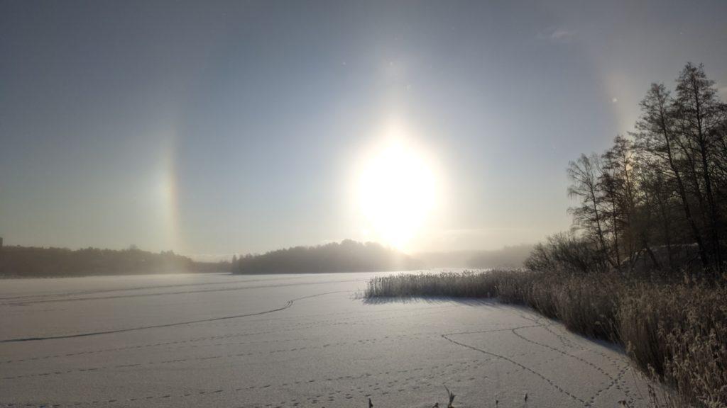 The sundogs optical phenomena over the frozen edsviken.